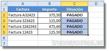 Insertar un dato en varias celdas en Excel: Valor PAGADO escrito en C2 y ampliado todo el rango hasta C5.